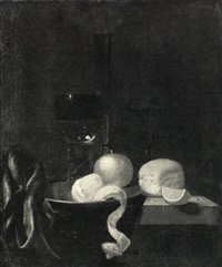 still life with a roemer, a facon de venise wineglass, an  orange and peeled lemon and other objects by simon luttichuys