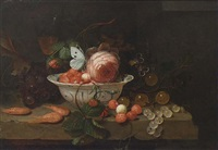 a stil life with a porcelain bowl with strawberries, a rose and a butterfly, a wineglass, grapes, prawns, gooseberries, all on a stone ledge by jan mortel