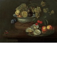 still life of fruit and oysters with a butterfly on a table by frans ykens