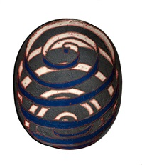 oval charger with pink and blue spirals by jun kaneko