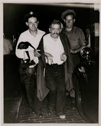 injured man by weegee