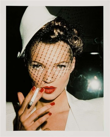 kate moss with flag in galliano, paris by roxanne lowit