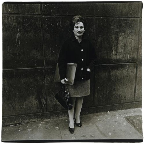 woman with a briefcase and pocketbook nyc by diane arbus