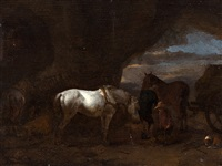 resting farmers in a grotto by philips wouwerman