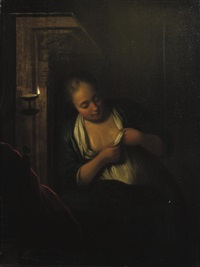 a young woman de-fleeing herself in a candlelit interior by michiel van muscher