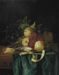 a venetian jug, façon de venise glass, lemons, grapes, oysters, shrimp and cobnuts on a silver platter and a knife and ring on a partially draped table by pieter de ring