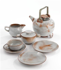 tea service comprising a teapot, milk jug, sugar bowl, teacup, saucer and two plates (set of 7) by otto lindig