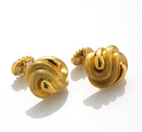a pair of cufflinks by henry dunay