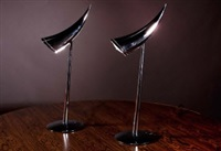 a pair of chrome ara lamps by philippe starck