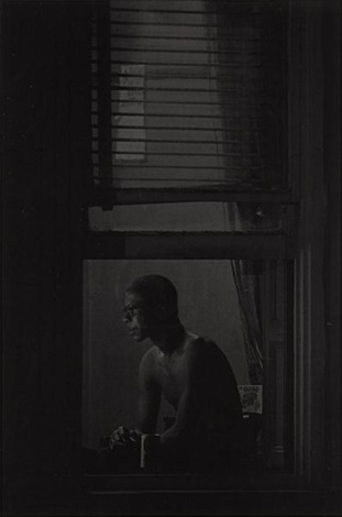 man in window by roy decarava