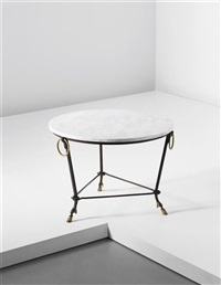 occasional table by gilbert poillerat et andré arbus