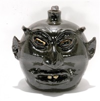 black-eyed devil rock tooth devil jug by lanier meaders