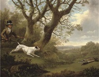 a bull terrier approaching a badger, with a servant looking on, in a landscape by charles towne the younger