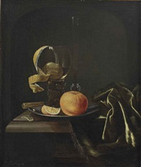 an orange, a peeled lemon and a glass on a pewter dish, all on a partially draped table by paul van den bosch