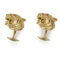 a pair of tiger's head cufflinks by kurt wayne