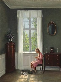 interior with a young girl and a playful cat at a window by hans hilsoe