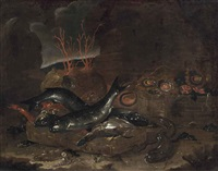 a basket of fish, an eel, shellfish and coral in a cave by giuseppe recco