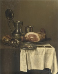 a pewter jug, a silver cup, a ham on a silver plate, a knife on a pewter plate and a roll of bread by gerrit willemsz heda