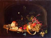 frutta, un calice di vino e altri oggetti in un vassoio by abraham mignon
