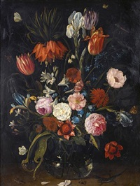 a still life of tulips, a crown imperial, snowdrops, lilies, irises, roses and other flowers in a glass vase by jan van kessel