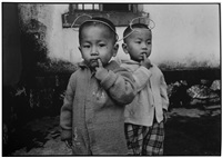 young boy with mickey mouse ears, yunnan province, china by mary ellen mark