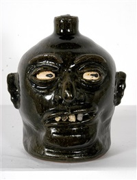 rock tooth face jug with left looking eyes by lanier meaders