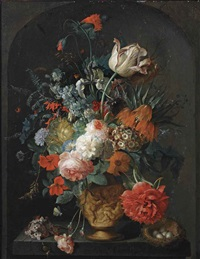 roses, tulips, anemones, irises, ranunculus, a larkspur, a hyacinth, auricula, a peony, a crown imperial lily and other flowers in a sculpted vase, with a snail and a bird's nest on a pedestal in a stone niche by coenraet (conrad) roepel