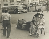 14th st. + 8th ave. – couple in front of their candy store by ruth orkin