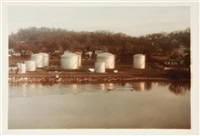 train and yellow car; blue box cars; gas tanks along the tennessee river, knoxville (3 works) by william eggleston