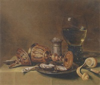 a roemer, an overturned goblet, oysters on a pewter plate, a silver salt, a knife and a peeled lemon on a draped table by gerrit willemsz heda