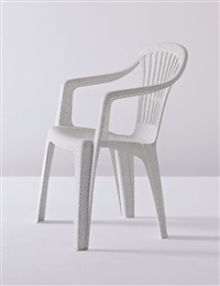 white plastic chair by tina roeder