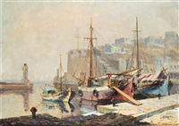 boats moored in a harbour by antonis kanas