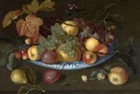 nature morte de prunes, pommes, poires et cerises dans une coupe de delft posée sur une table et entourée d'insectes by johannes bosschaert