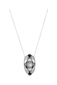 a moonstone, onyx and diamond pendant necklace by tiffany & company