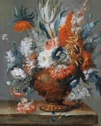 blumenstillleben mit einer ornamentierten vase auf einer steinbrüstung by karel van vogelaer