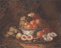 grapes, peaches and a pomegranate in a blue and white porcelain bowl with peaches and shrimps in a pewter plate on a forest floor, with grapes, oysters and a snail by thomas mertens