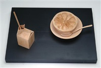 half grapefruit in a bowl and a juice carton with straw by fumio yoshimura