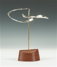 silver mobile with teakwood base by russell secrest