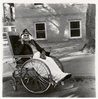 masked woman in wheelchair, pa by diane arbus