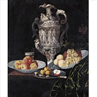 still life with an elaborately sculpted urn and blue and white porcelain bowls with fruit by georg hainz
