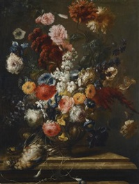 a still life of flowers in an urn on a marble ledge with a bird by franz werner von tamm