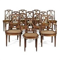 suite comprising a pair of armchairs and 10 chairs (set of 12) by georges jacob