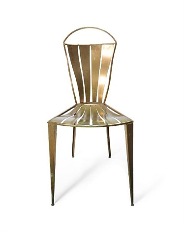 a metal chair by tom dixon