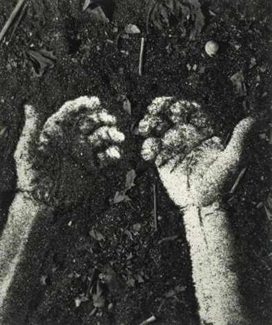 hands picture of soil by vik muniz