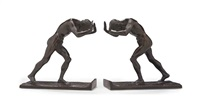 pushing men: bookends (pair) by isidore konti