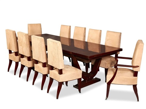 A French Art Deco Rosewood Dining Table And Ten Suede Upholstered Chairs By Maison Dominique
