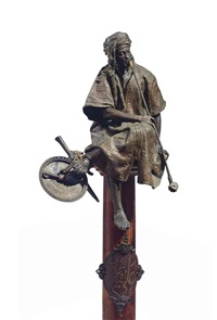 figure entitled le fumeur, on pedestal by gaston veuvenot leroux
