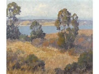 trees and autumn grasses with a lake beyond by maurice braun