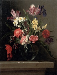tulips, carnations, narcissi and other flowers in a glass vase, on a stone ledge by jean-michel picart