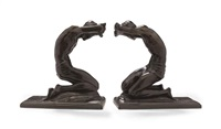 kneeling men: bookends (pair) by isidore konti